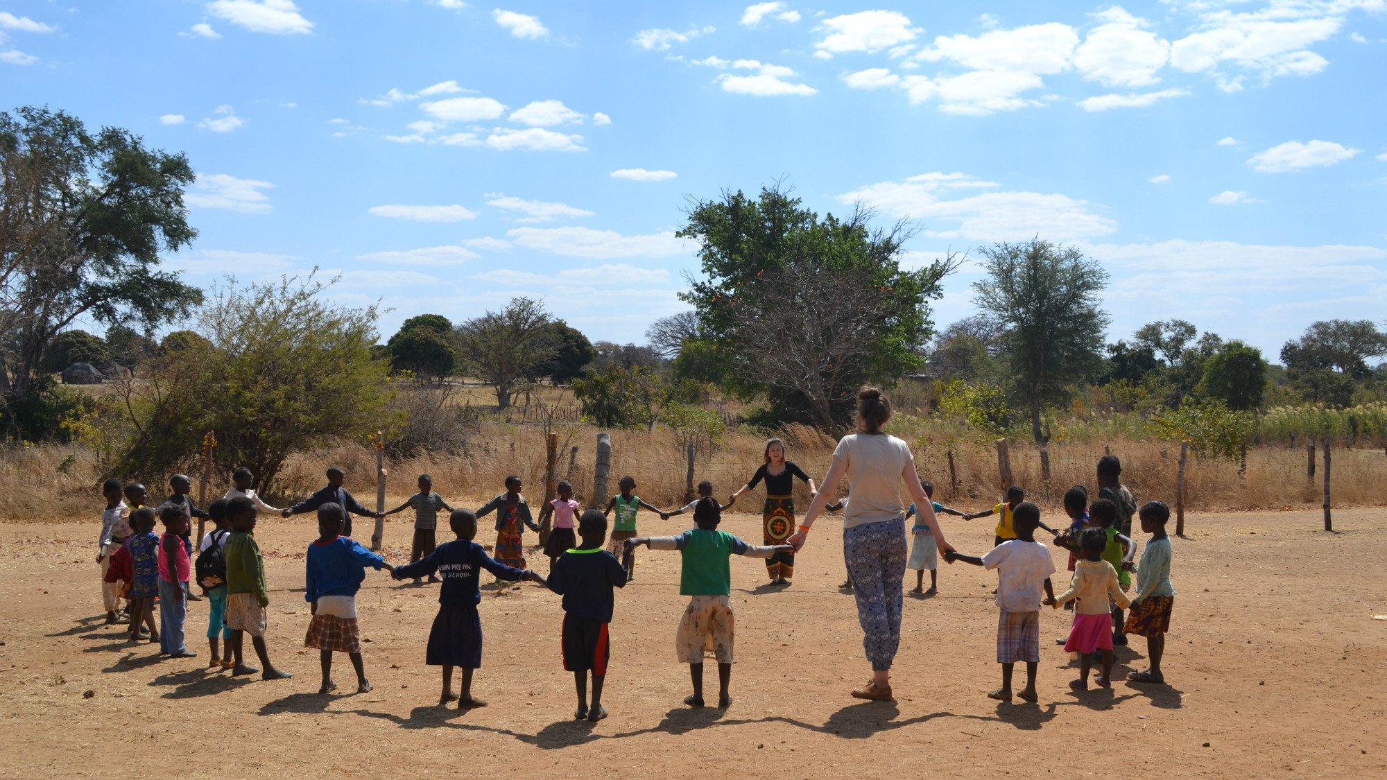 P.I.E.C.E.S. Volunteers with a class in Zambia