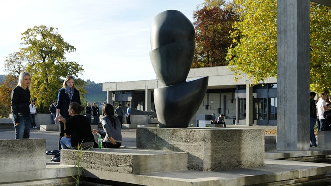 """Students and """"Schalenbaum"""" by Hans Arp in front of the University of St.Gallen (HSG) main building"""