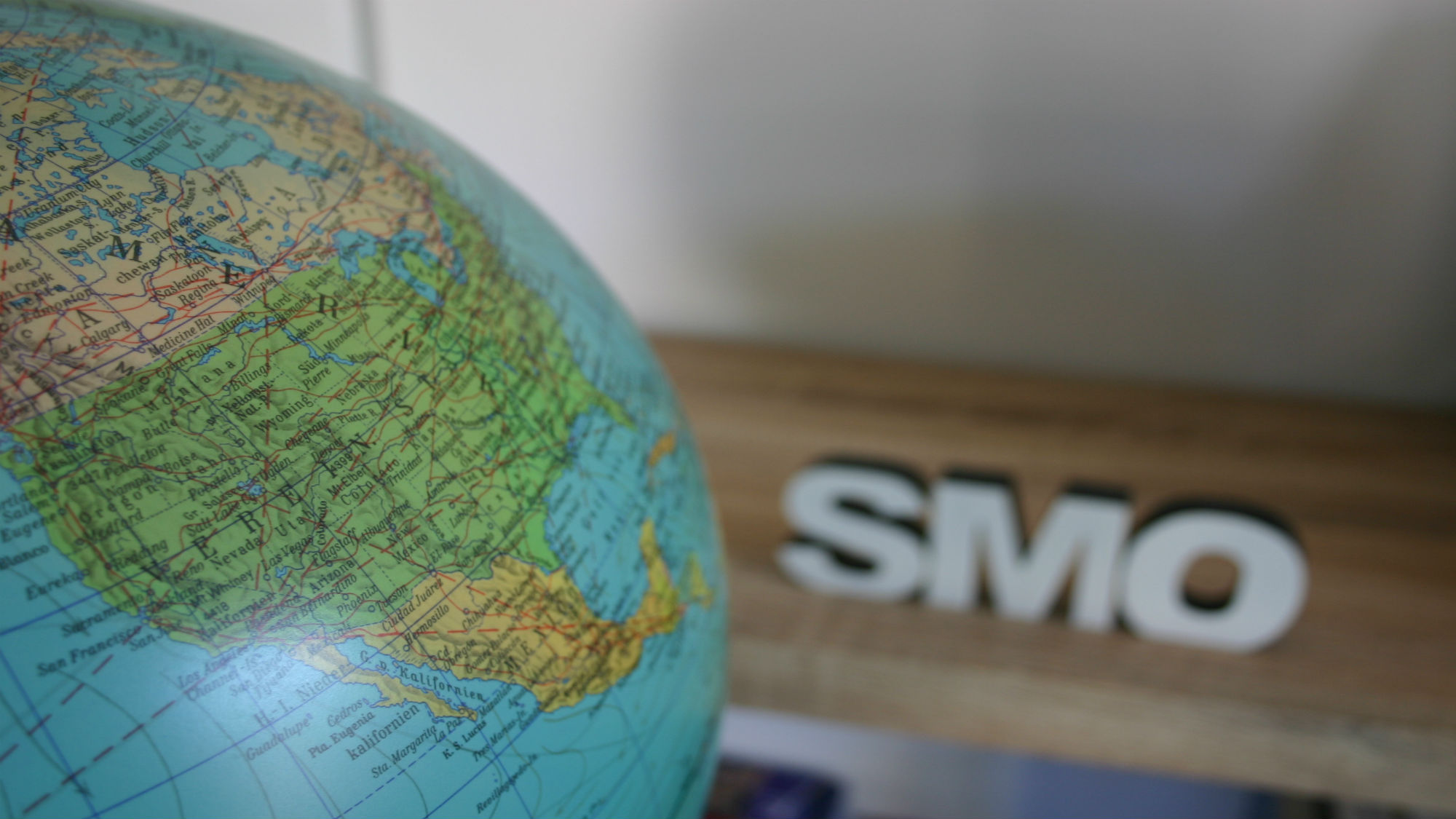 Globe and SMO lettering