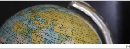 Part of a terrestrial globe as focal point of the camera.