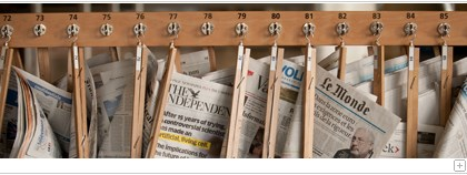 Newspapers on a news rack