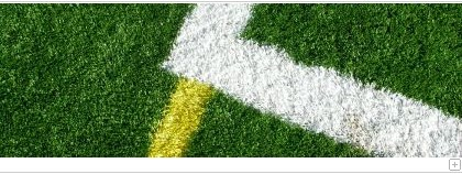 Green astroturf with different lines.