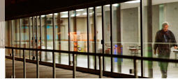 Insight into the brightly illuminated corridor within the Main Building of the University of St.Gallen by night.