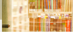 Artful, blurred picture of a colourful bookshelf.