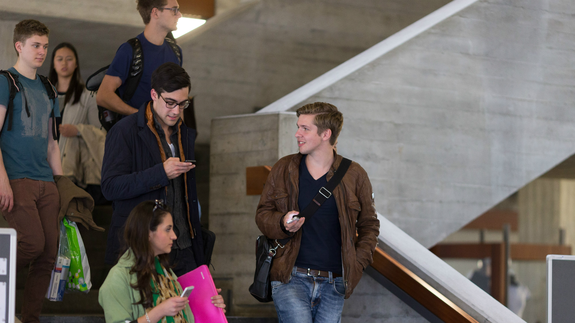 Students on the stairs in the Main Building at the University of St.Gallen (HSG)