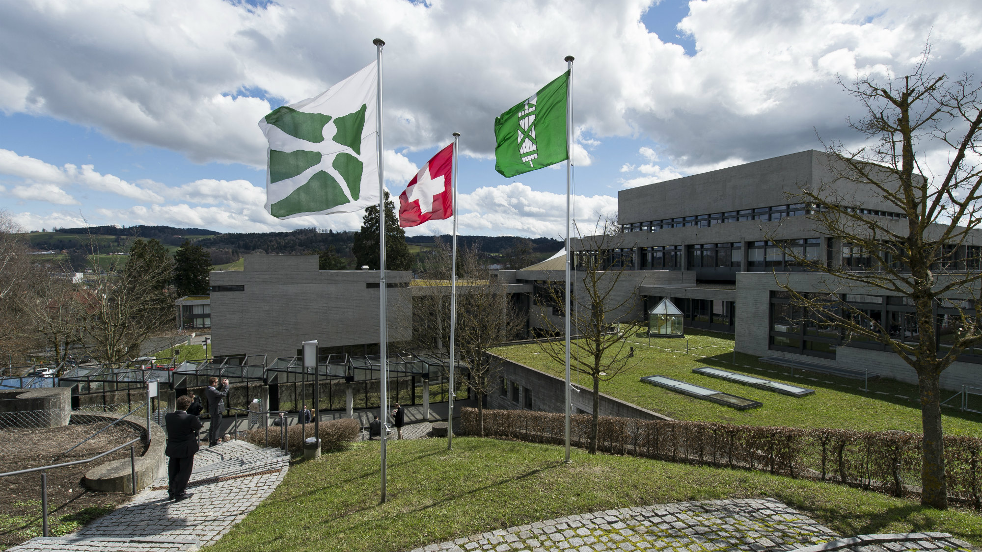 Flag of Switzerland, of the canton of St.Gallen and of the University of St.Gallen (HSG)