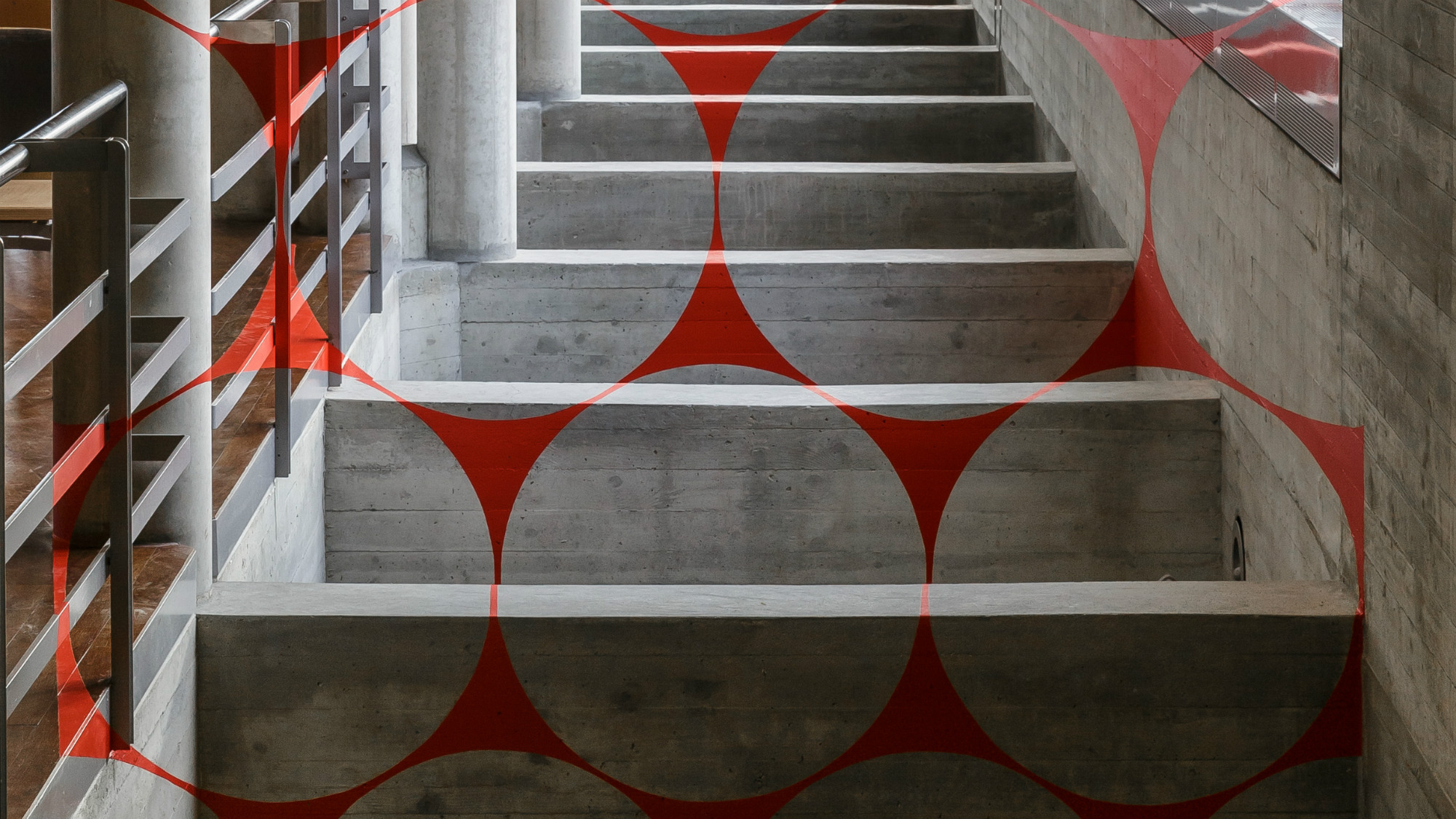 Felice Varini's red, three-dimensional work of art, installed in the Library Building of the University of St.Gallen (HSG)