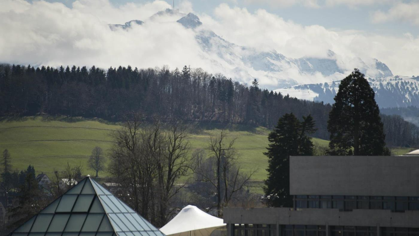 Photograph of the Library Building's pyramid of the University of St.Gallen (HSG) with the mountains in the background